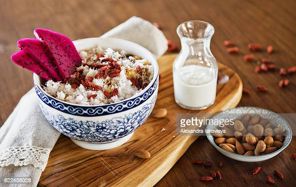 Muesli served with dragon fruit, almonds, goji berries and coconut
