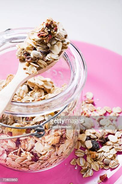 muesli with dried fruit in preserving jar - rolled oats stock photos and pictures