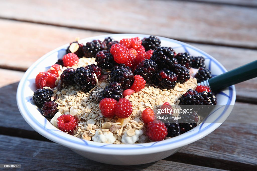 Mueslie with fresh wild berries : Stock Photo