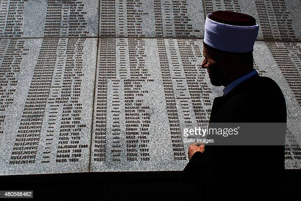 Muezzin prayss on July 11 2015 at the Srebrenica Potocari Memorial and Cemetery at Potocari Bosnia During the 19921995 Bosnian War the town of...