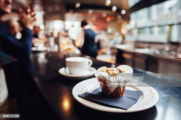 Muffin and capuccino on coffee shop