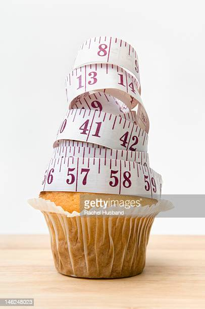 Muffin with tape measure on top