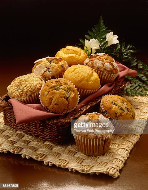 muffins in basket -  firak stock pictures, royalty-free photos & images