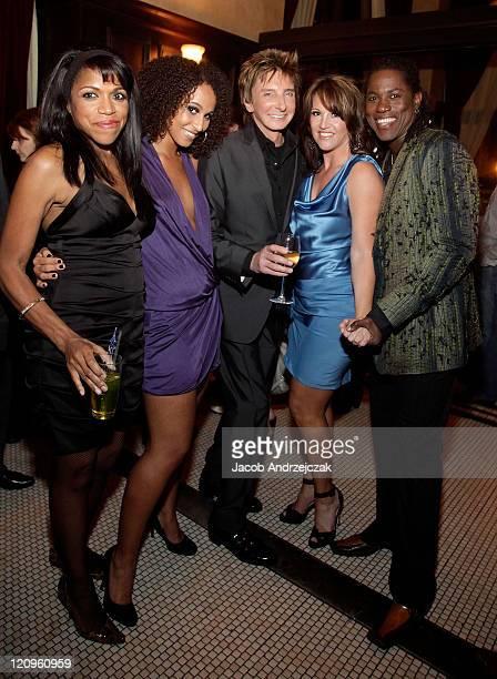Muffy Hendrix Melanie Nyema singersongwriter Barry Manilow Keely Vasquez and Kye Brackett pose at Mon Ami Gabi French Bistro at the Paris Las Vegas...