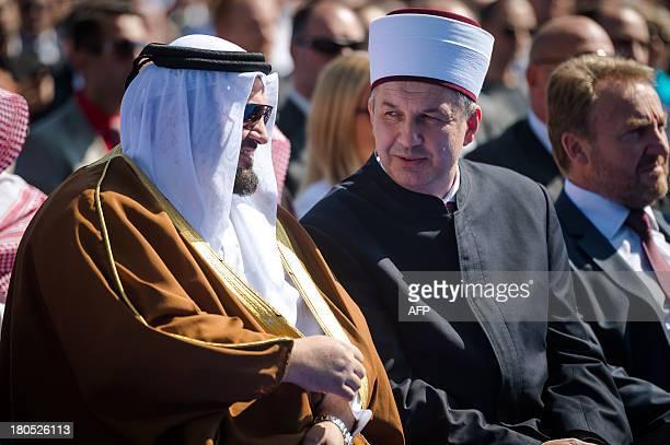 Mufti Nedzad Grabus talks on September 14 2013 with Qatari Minister of Awqaf and Islamic Affairs Ghaith bin Mubarak alKuwari during a ceremony in...