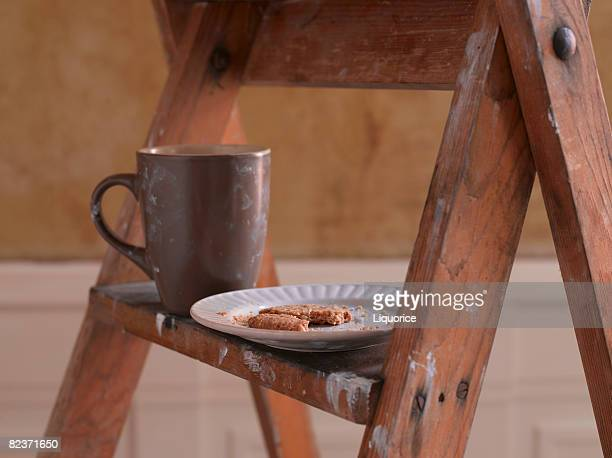 mug and biscuits on ladder