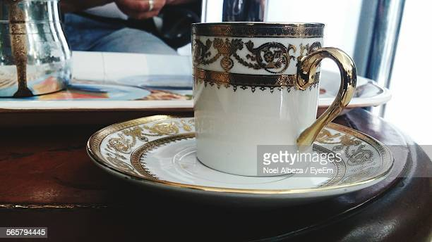 Mug And Saucer With Gold Ornament