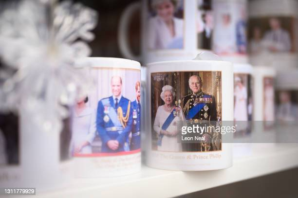 Mug featuring a photograph of Prince Philip, Duke Of Edinburgh who died at age 99, is seen in a gift shop window near to Windsor Castle on April 10,...