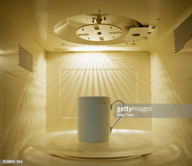 Mug inside microwave, close-up