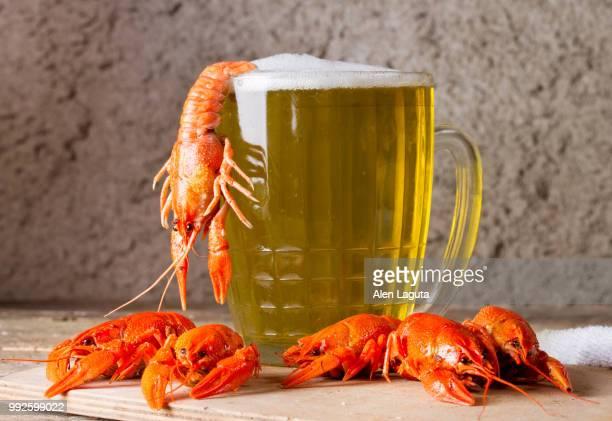 Mug of beer and boiled crawfish