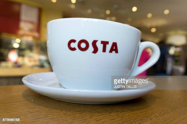 A mug of coffee is pictured inside a branch of a Costa coffee shop in London on November 17 2017 / AFP PHOTO / Justin TALLIS