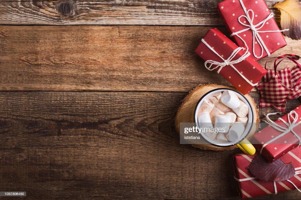 Mug of hot chocolate and Christmas gift boxes : Stock Photo