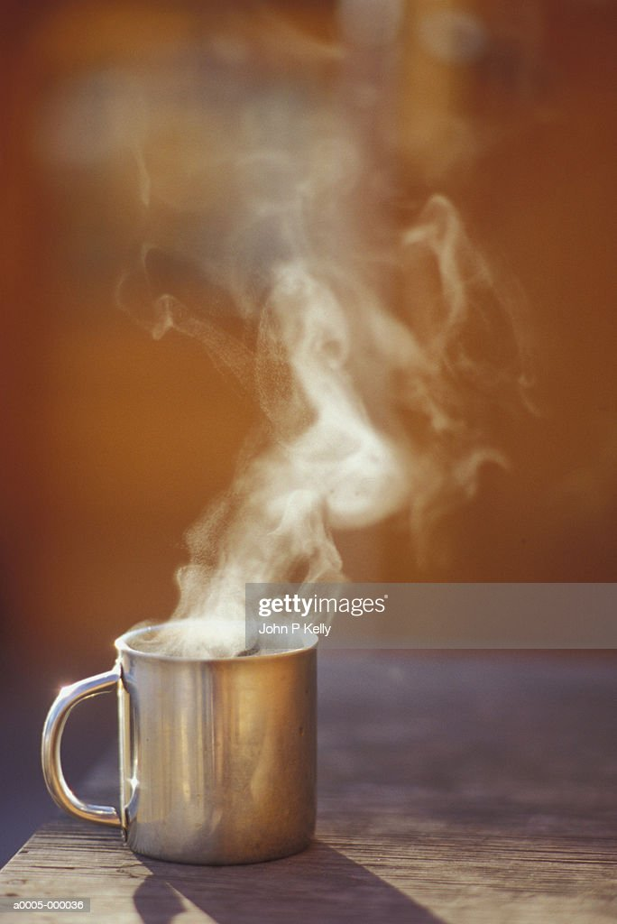 cbdba52524d Mug Of Steaming Hot Coffee Stock Photo - Getty Images