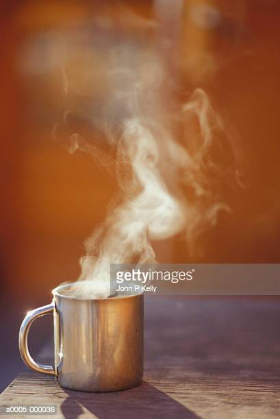 mug of steaming hot coffee - steam stock pictures, royalty-free photos & images