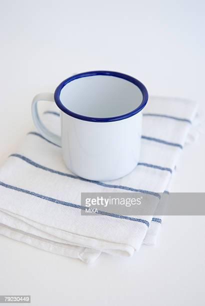 Mug on kitchen cloth