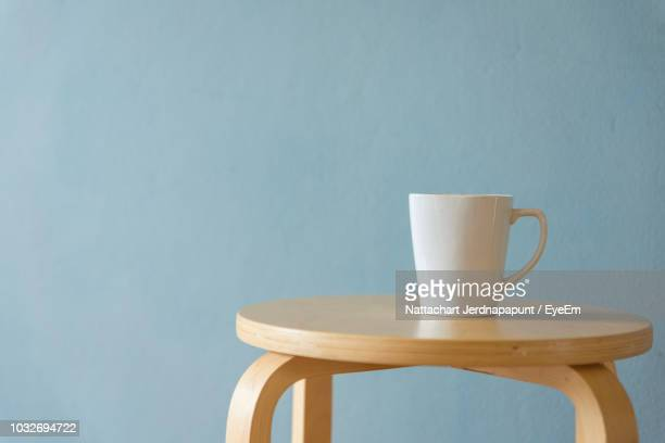 Mug On Stool Against Blue Background