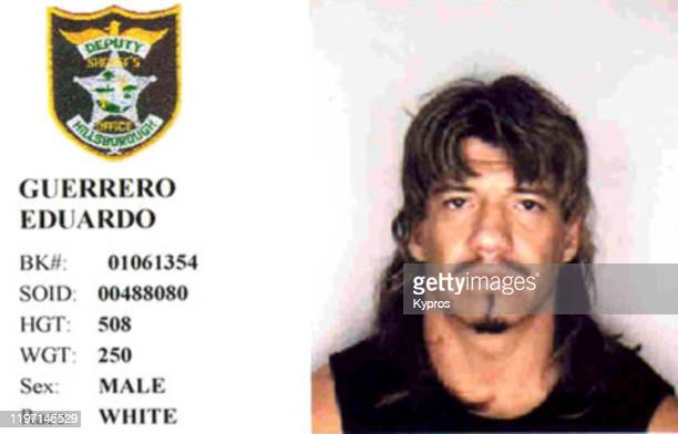 Mug shot of American wrestler Eduardo 'Eddie' Guerrero , following his arrest in Hillsborough County, Florida for drink driving, November 2001. He...