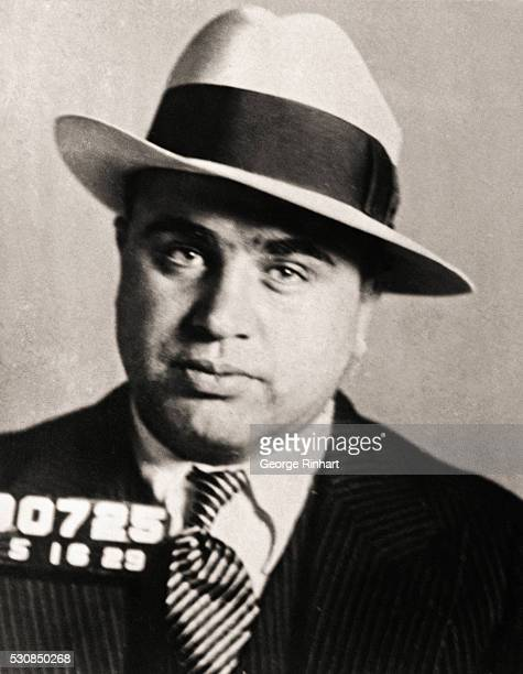 mug shot of Chicago Mobster Al Capone wearing a hat and looking straight into the camera An undated photograph