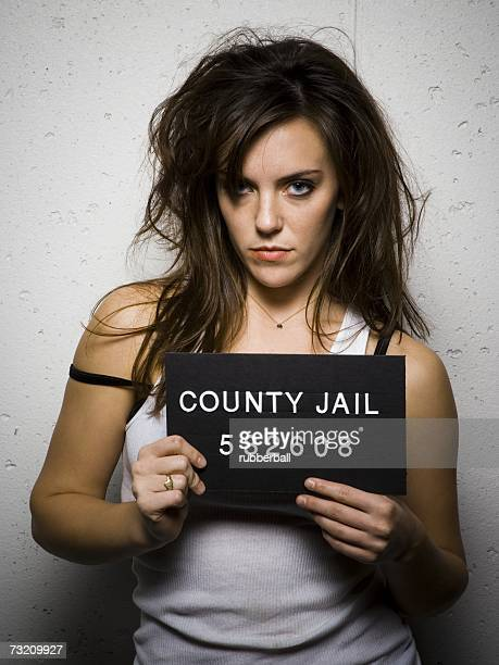 mug shot of disheveled woman - redneck woman stock photos and pictures