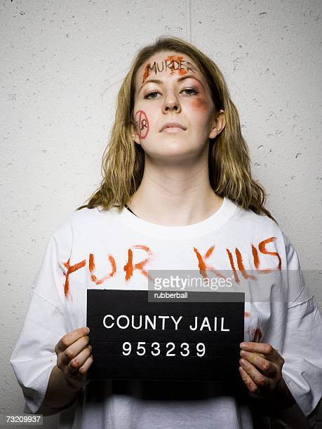 mug shot of female activist - prisoner photos stock pictures, royalty-free photos & images