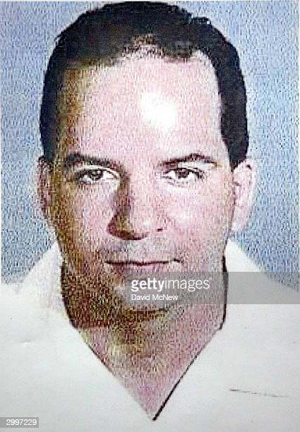 A mug shot of Johnny Ray Gasca is seen on an FBI wanted poster at a press conference to unveil an FBI antipiracy seal and warning text to be...