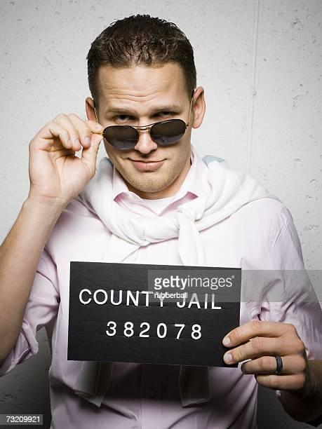 Mug shot of stylish man with sunglasses