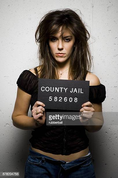 mug shot of woman with messy hair - redneck woman stock photos and pictures