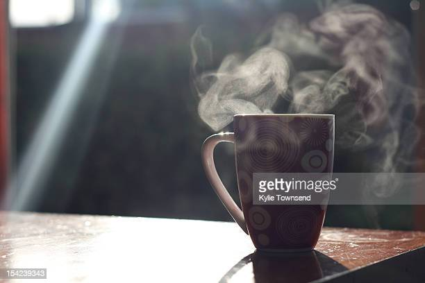 Mug with sunlight and steam