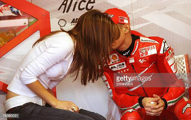Australian Casey Stoner on a Ducati kisses hsi wife Adriana in the paddock during the qualifying rounds of the Italian MotoGP Grand Prix at Mugello's...