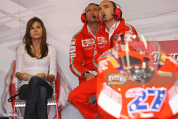 Australian Casey Stoner's wife Adriana looks at the race in the paddock during the qualifying rounds of the Italian MotoGP Grand Prix at Mugello's...