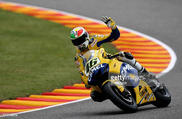 Moto GP Yamaha rider Italy's Valentino Rossi waves to supporters at the end of the qualifying practice session of the Italian MotoGP Grand Prix at...