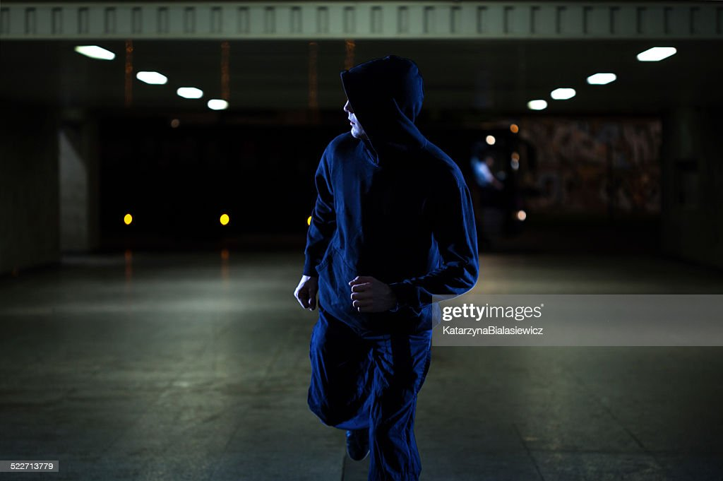 Mugger running in the underpass : Stock Photo