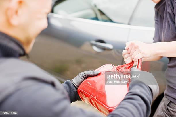 mugger stealing handbag - handtas stockfoto's en -beelden