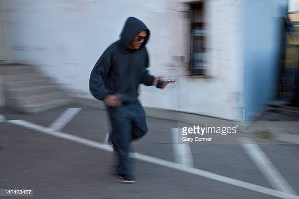 Mugger with pistol in alley