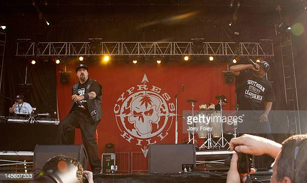 DJ Muggs BReal Eric Bobo and Sen Dog of Cypress Hill performs live during the 2012 Rock On The Range festival at Crew Stadium on May 19 2012 in...