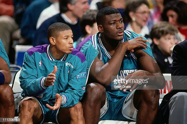 Muggsy Bogues and Larry Johnson of the Charlotte Hornets sit on the bench against the Portland Trailblazers at the Veterans Memorial Coliseum in 1992...