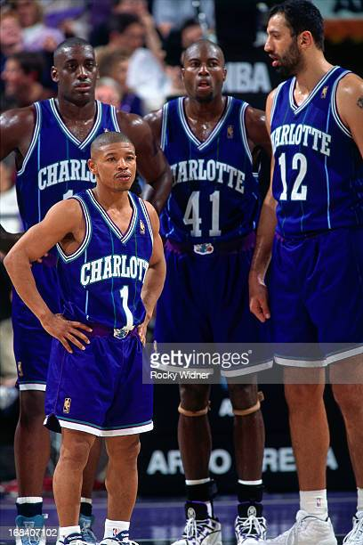 Muggsy Bogues, Anthony Mason, Glen Rice and Vlade Divac of the Charlotte Hornets stand against the Sacramento Kings during a game played on January...