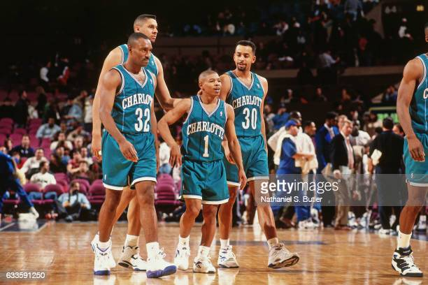 Muggsy Bogues Dell Curry and LeRon Ellis of the Charlotte Hornets walk against the New York Knicks on January 2 1994 at Madison Square Garden in New...
