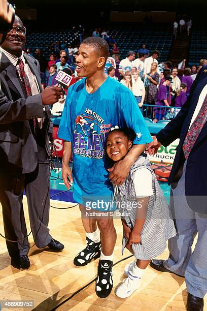 Muggsy Bogues of the Charlotte Hornets and his daughter Brittney speaks to the media after the game against the Boston Celtics in Game Four of the...
