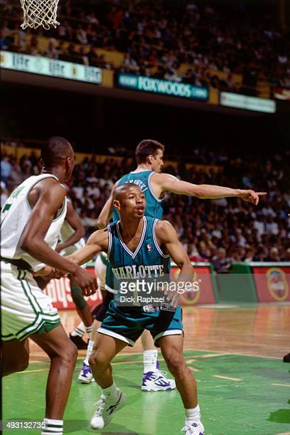 Muggsy Bogues of the Charlotte Hornets defends against Dee Brown of the Boston Celtics during a game played circa 1994 at the Boston Garden in Boston...