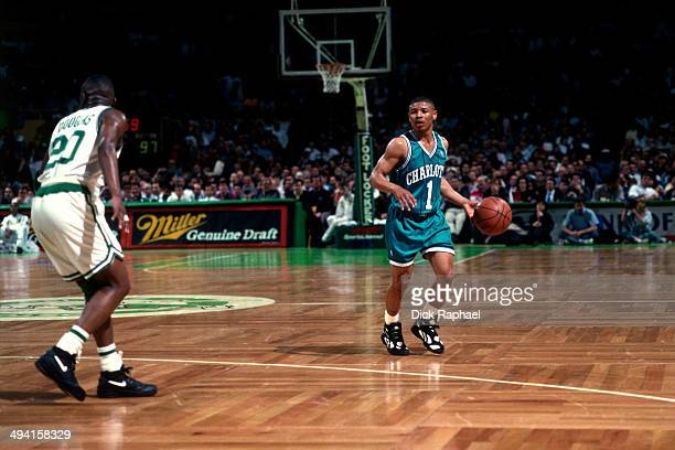 Muggsy Bogues of the Charlotte Hornets dribbles against Sherman Douglas of the Boston Celtics during a game played at the Boston Garden in Boston...
