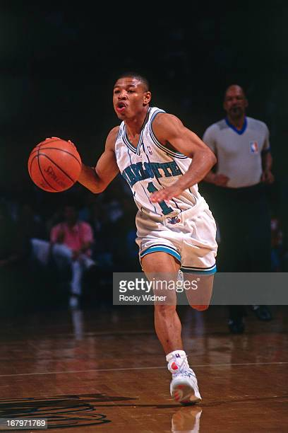Muggsy Bogues of the Charlotte Hornets dribbles the ball against the Atlanta Hawks during a game played on March 20 1992 at the Charlotte Coliseum in...
