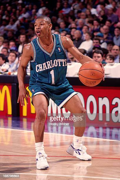 Muggsy Bogues of the Charlotte Hornets dribbles the ball against the Sacramento Kings during a game played on January 13 1994 at Arco Arena in...