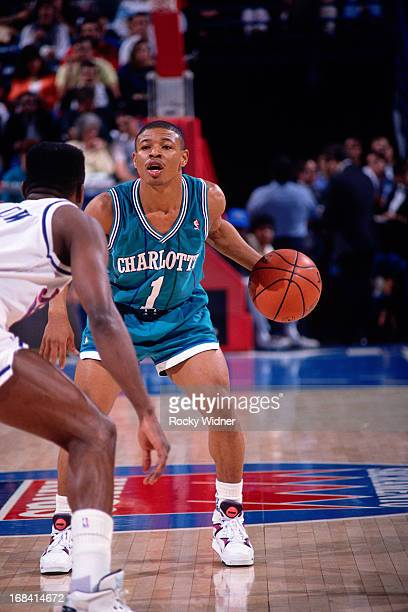 Muggsy Bogues of the Charlotte Hornets dribbles the ball against the Sacramento Kings during a game played on February 27 1991 at Arco Arena in...