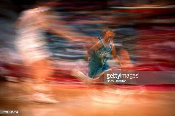 Muggsy Bogues of the Charlotte Hornets dribbles the ball against the Atlanta Hawks at the Omni Coliseum in Atlanta Georgia circa 1992 NOTE TO USER...