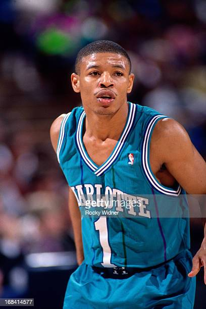 Muggsy Bogues of the Charlotte Hornets looks on against the Sacramento Kings during a game played on February 27 1991 at Arco Arena in Sacramento...