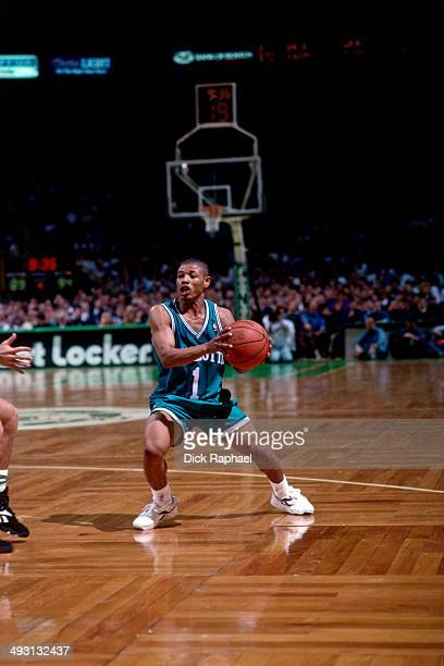 Muggsy Bogues of the Charlotte Hornets looks to pass against the Boston Celtics during a game played circa 1994 at the Boston Garden in Boston...