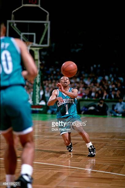 Muggsy Bogues of the Charlotte Hornets makes a pass against the Boston Celtics during a game played at the Boston Garden in Boston Massachusetts...