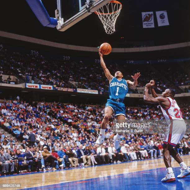 Muggsy Bogues of the Charlotte Hornets shoots against the New Jersey Nets during a game played circa 1993 at the Brendan Byrne Arena in East...