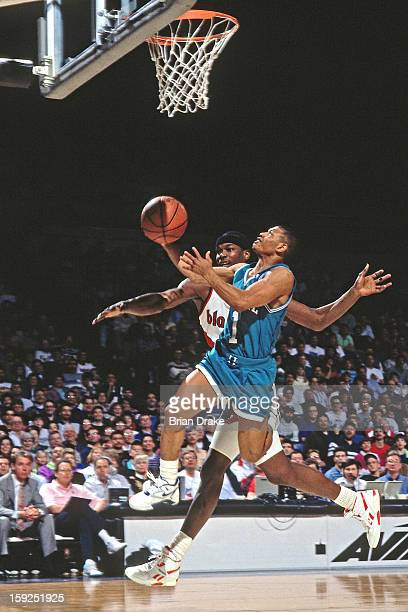 Muggsy Bogues of the Charlotte Hornets shoots the ball against the Portland Trail Blazers during a game played at the Veterans Memorial Coliseum in...